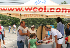 WCOL, local country station, giving away prizes and hosting karaoke contest