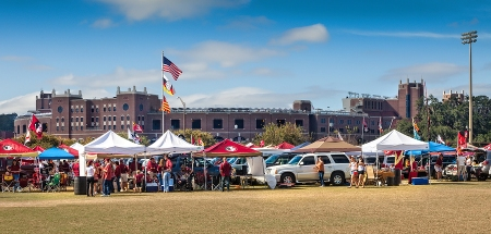 TALLAHASSEE, FL - NOV. 16 2013: FSU fans tailgating outside Doak Campbell Stadium before a home game against Syracuse University. Most of the tailgating are the open parking lots owned by the Booster Club outside the stadium.